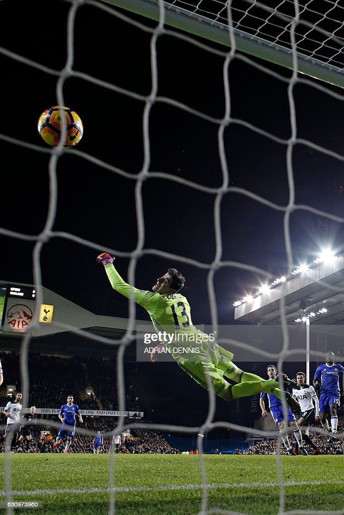 Chelsea's Belgian goalkeeper Thibaut Courtois (C) cannot stop the header from Tottenham Hotspur's English midfielder Dele Alli (2nd R) as Tottenham take the lead during the English Premier League football match between Tottenham Hotspur and Chelsea at White Hart Lane in London, on January 4, 2017. / AFP / Adrian DENNIS / RESTRICTED TO EDITORIAL USE. No use with unauthorized audio, video, data, fixture lists, club/league logos or 'live' services. Online in-match use limited to 75 images, no video emulation. No use in betting, games or single club/league/player publications. /