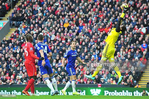 Chelsea's Belgian goalkeeper Thibaut Courtois catches the ball during the English Premier League football match between Liverpool and Chelsea at...