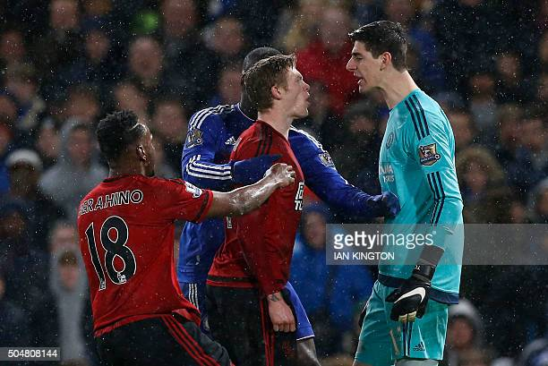 Chelsea's Belgian goalkeeper Thibaut Courtois clashes with West Bromwich Albion's Irish midfielder James McClean during the English Premier League...