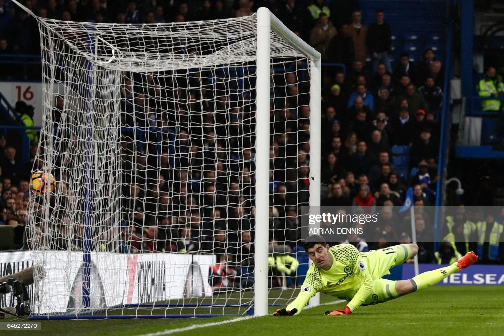 Chelsea's Belgian goalkeeper Thibaut Courtois (R) dives but fails to stop the header from Swansea City's Spanish striker Fernando Llorente for Swansea's equalising goal during the English Premier League football match between Chelsea and Swansea at Stamford Bridge in London on February 25, 2017. / AFP / Adrian DENNIS / RESTRICTED TO EDITORIAL USE. No use with unauthorized audio, video, data, fixture lists, club/league logos or 'live' services. Online in-match use limited to 75 images, no video emulation. No use in betting, games or single club/league/player publications. /