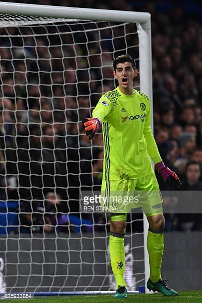 Chelsea's Belgian goalkeeper Thibaut Courtois gestures to his defence during the English Premier League football match between Chelsea and Tottenham...