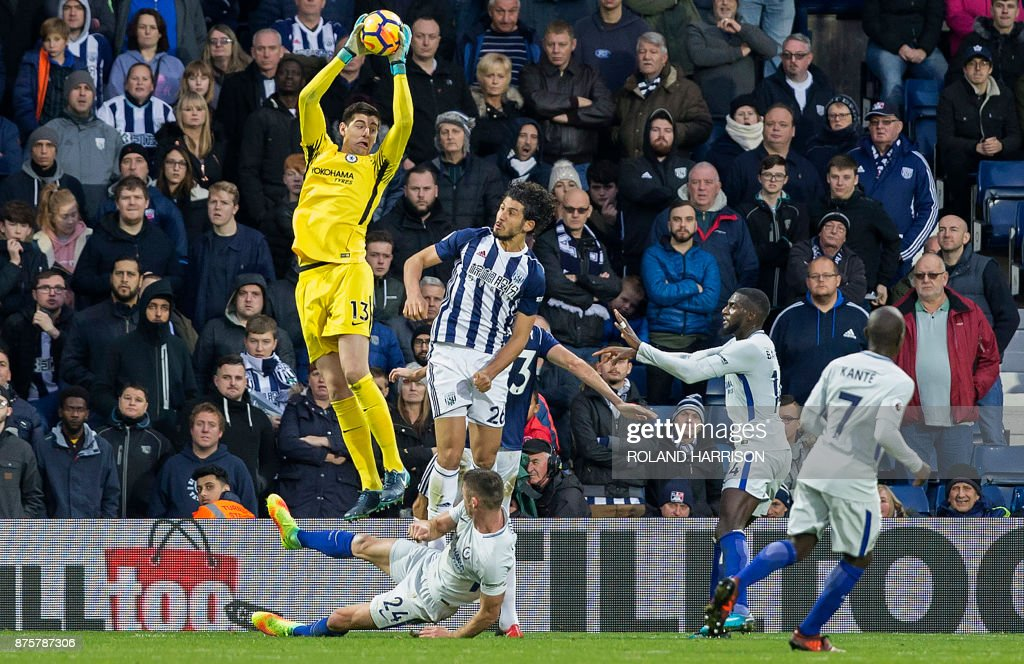 TOPSHOT - Chelsea's Belgian goalkeeper Thibaut Courtois jumps to catch a ball during the English Premier League football match between West Bromwich Albion and Chelsea at The Hawthorns stadium in West Bromwich, central England, on November 18, 2017. PHOTO / Roland Harrison / RESTRICTED TO EDITORIAL USE. No use with unauthorized audio, video, data, fixture lists, club/league logos or 'live' services. Online in-match use limited to 75 images, no video emulation. No use in betting, games or single club/league/player publications. /
