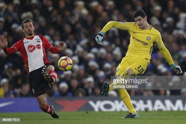 Chelsea's Belgian goalkeeper Thibaut Courtois kicks the ball past Southampton's Italian striker Manolo Gabbiadini during the English Premier League...