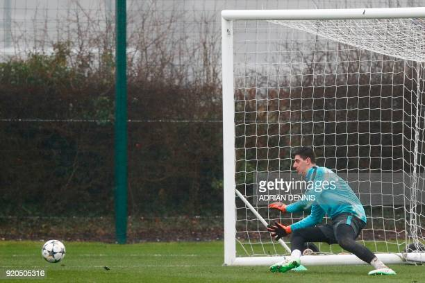 Chelsea's Belgian goalkeeper Thibaut Courtois practices his saves during a training session at Chelsea's Cobham training facility in Stoke D'Abernon...