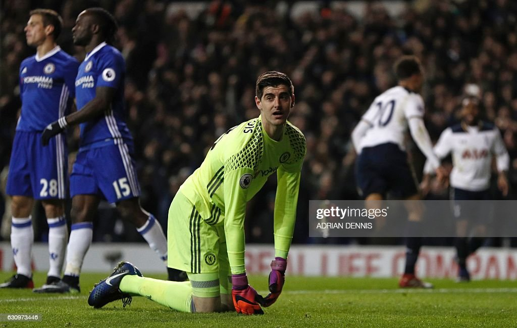 Chelsea's Belgian goalkeeper Thibaut Courtois (C) reacts as Tottenham Hotspur's English midfielder Dele Alli (2nd R) runs off to celebrate scoring the opening goal of the English Premier League football match between Tottenham Hotspur and Chelsea at White Hart Lane in London, on January 4, 2017. / AFP / Adrian DENNIS / RESTRICTED TO EDITORIAL USE. No use with unauthorized audio, video, data, fixture lists, club/league logos or 'live' services. Online in-match use limited to 75 images, no video emulation. No use in betting, games or single club/league/player publications. /