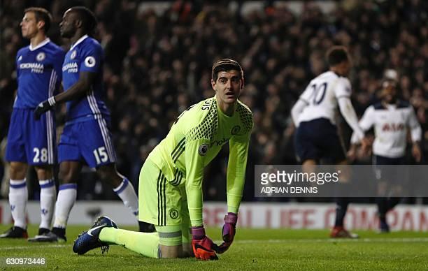 Chelsea's Belgian goalkeeper Thibaut Courtois reacts as Tottenham Hotspur's English midfielder Dele Alli runs off to celebrate scoring the opening...