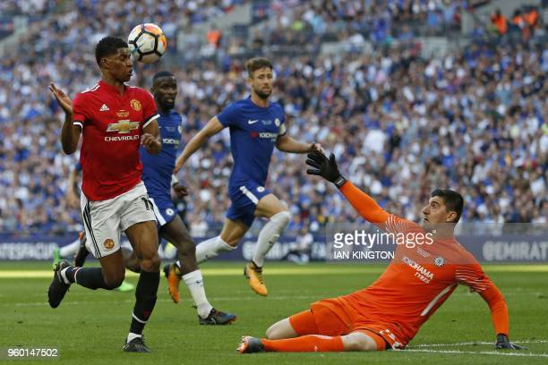 Chelsea's Belgian goalkeeper Thibaut Courtois saves this attempt from Manchester United's English striker Marcus Rashford during the English FA Cup...