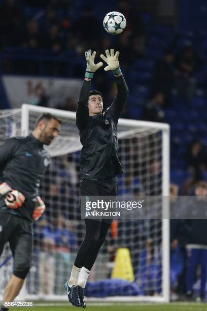 Chelsea's Belgian goalkeeper Thibaut Courtois warms up ahead of the UEFA Champions League Group C football match between Chelsea and Atletico Madrid...