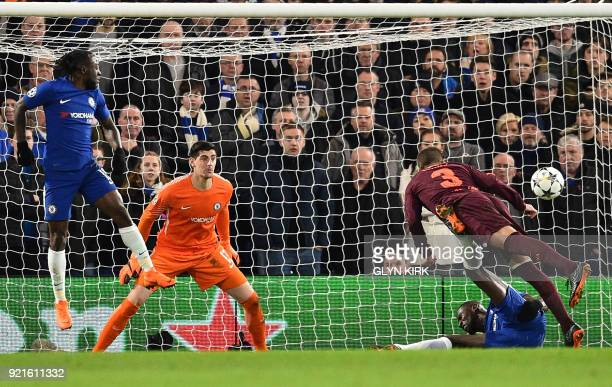 TOPSHOT Chelsea's Belgian goalkeeper Thibaut Courtois watches a shot go wide during the first leg of the UEFA Champions League round of 16 football...