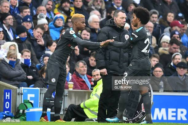 Chelsea's Belgian midfielder Charly Musonda replaces Chelsea's Brazilian midfielder Willian during the English Premier League football match between...