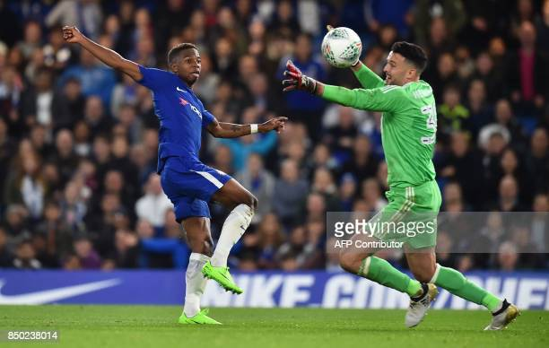 Chelsea's Belgian midfielder Charly Musonda shoots past Nottingham Forest's Irish goalkeeper Stephen Henderson but fails to score during the English...