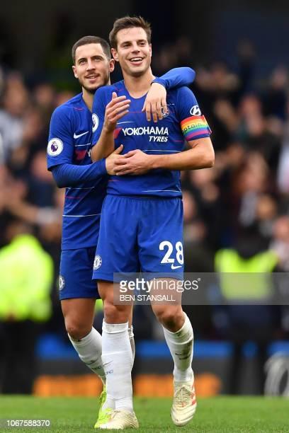 Chelsea's Belgian midfielder Eden Hazard and Chelsea's Spanish defender Cesar Azpilicueta celebrates on the pitch after the English Premier League...