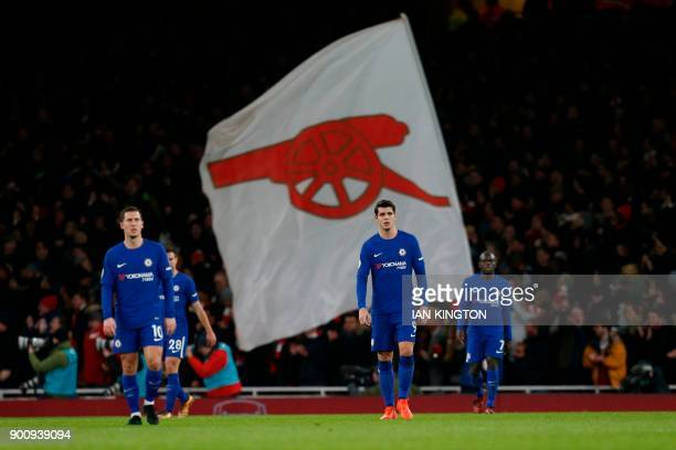 Chelsea's Belgian midfielder Eden Hazard and Chelsea's Spanish striker Alvaro Morata react after Arsenal scored during the English Premier League...