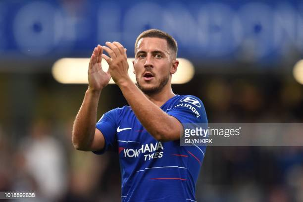 Chelsea's Belgian midfielder Eden Hazard applauds supporters on the pitch after the English Premier League football match between Chelsea and Arsenal...