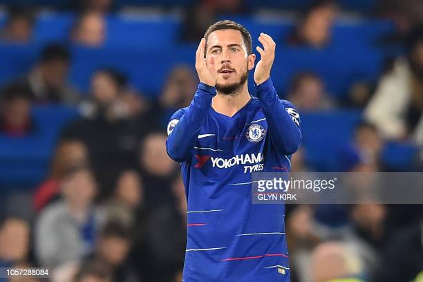 Chelsea's Belgian midfielder Eden Hazard applauds supporters on the pitch after the English Premier League football match between Chelsea and Crystal...