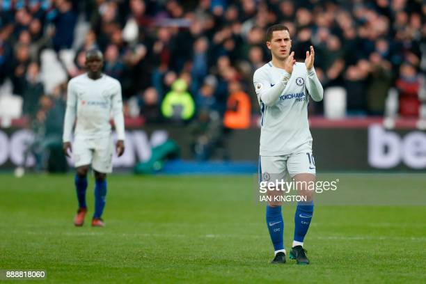 Chelsea's Belgian midfielder Eden Hazard applauds supporters on the pitch after the English Premier League football match between West Ham United and...