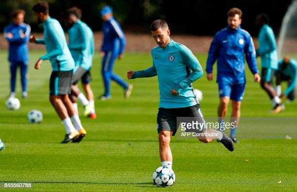 Chelsea's Belgian midfielder Eden Hazard attends a team training session at Chelsea's Cobham training facility in Stoke D'Abernon southwest of London...