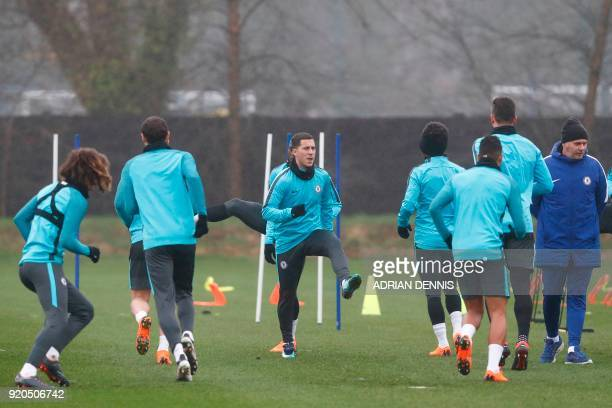 Chelsea's Belgian midfielder Eden Hazard attends a training session at Chelsea's Cobham training facility in Stoke D'Abernon southwest of London on...