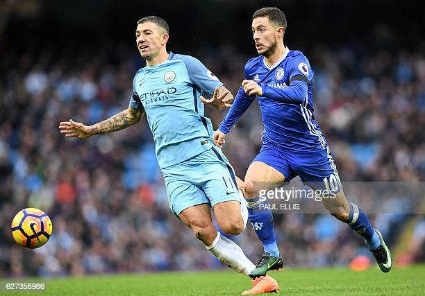 Chelsea's Belgian midfielder Eden Hazard breaks away from Manchester City's Serbian defender Aleksandar Kolarov to scores his team's thrid goal...