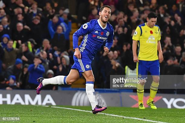 Chelsea's Belgian midfielder Eden Hazard celebrates after scoring their fourth goal during the English Premier League football match between Chelsea...