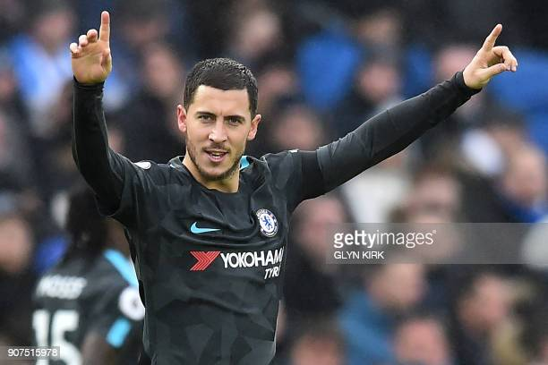 Chelsea's Belgian midfielder Eden Hazard celebrates after scoring their third goal during the English Premier League football match between Brighton...