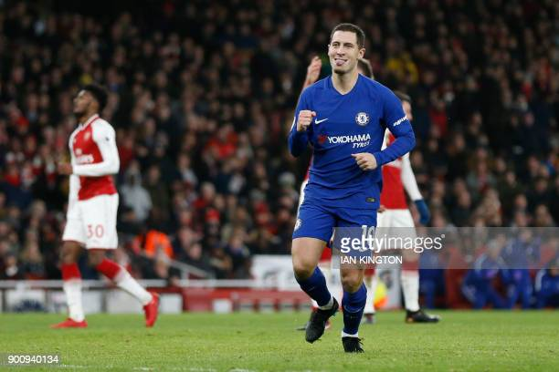 Chelsea's Belgian midfielder Eden Hazard celebrates after scoring during the English Premier League football match between Arsenal and Chelsea at the...