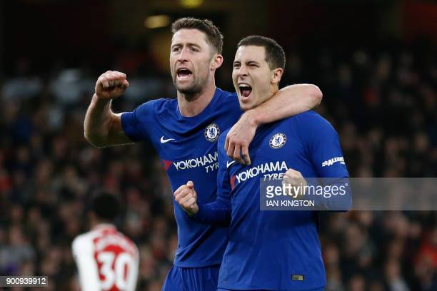 Chelsea's Belgian midfielder Eden Hazard celebrates after scoring with Chelsea's English defender Gary Cahill during the English Premier League...