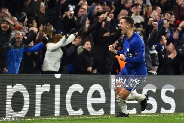 Chelsea's Belgian midfielder Eden Hazard celebrates an own goal by Atletico Madrid's Montenegrin defender Stefan Savic during a UEFA Champions League...