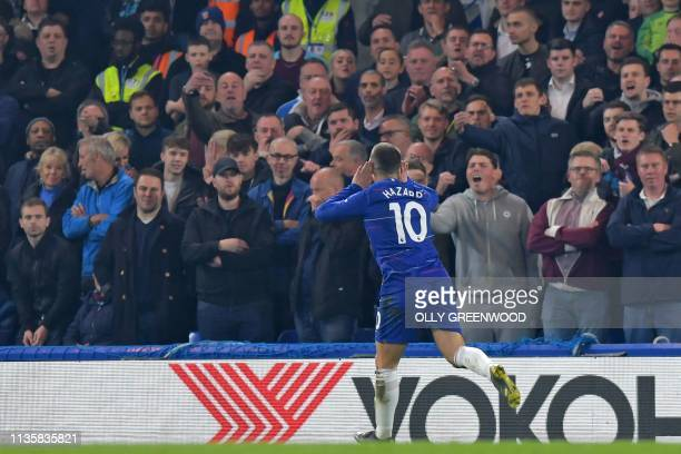 Chelsea's Belgian midfielder Eden Hazard celebrates in front of the West ham fans after scoring the opening goal during the English Premier League...