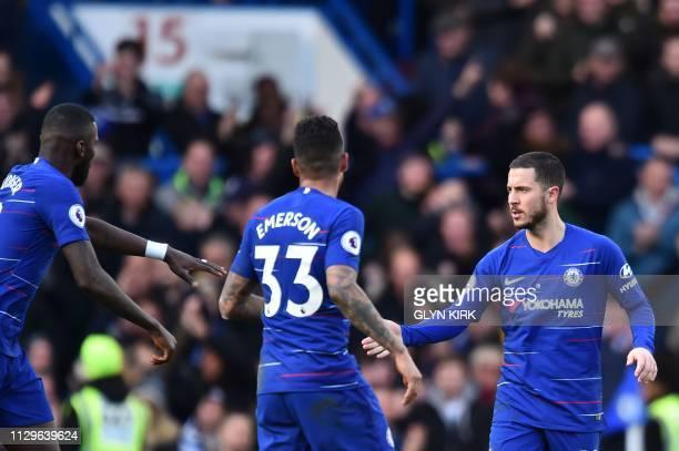 Chelsea's Belgian midfielder Eden Hazard celebrates scoring a late equalising goal during the English Premier League football match between Chelsea...