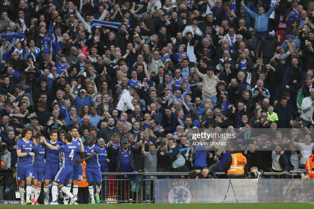 Chelsea's Belgian midfielder Eden Hazard (2L) celebrates scoring Chelsea's third goal during the FA Cup semi-final football match between Tottenham Hotspur and Chelsea at Wembley stadium in London on April 22, 2017. / AFP PHOTO / Adrian DENNIS / NOT