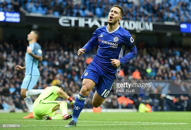 Chelsea's Belgian midfielder Eden Hazard celebrates scoring his team's third goal during the English Premier League football match between Manchester...