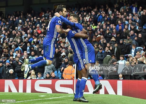 Chelsea's Belgian midfielder Eden Hazard celebrates scoring his team's third goal during the English Premier League football match between Manchester...