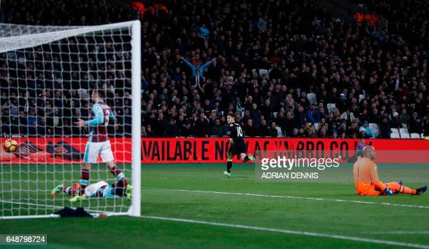 Chelsea's Belgian midfielder Eden Hazard celebrates scoring his team's first goal during the English Premier League football match between West Ham...
