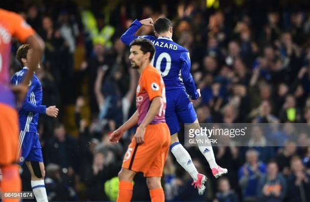 Chelsea's Belgian midfielder Eden Hazard celebrates scoring his team's first goal during the English Premier League football match between Chelsea...
