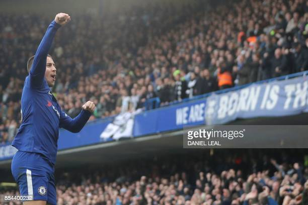 Chelsea's Belgian midfielder Eden Hazard celebrates scoring his team's first goal during the English Premier League football match between Chelsea...