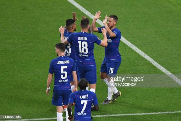 Chelsea's Belgian midfielder Eden Hazard celebrates scoring the 30 goal from the penalty spot with his teammates during the UEFA Europa League final...