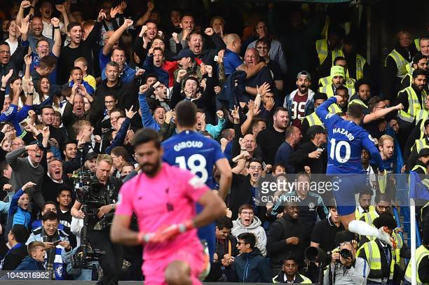 Chelsea's Belgian midfielder Eden Hazard celebrates scoring the team's first goal during the English Premier League football match between Chelsea...