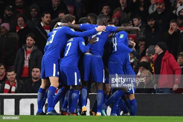 Chelsea's Belgian midfielder Eden Hazard celebrates scoring the team's first goal during the League Cup semifinal football match between Arsenal and...