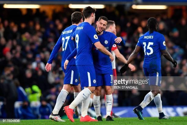 Chelsea's Belgian midfielder Eden Hazard celebrates scoring their third goal during the English Premier League football match between Chelsea and...