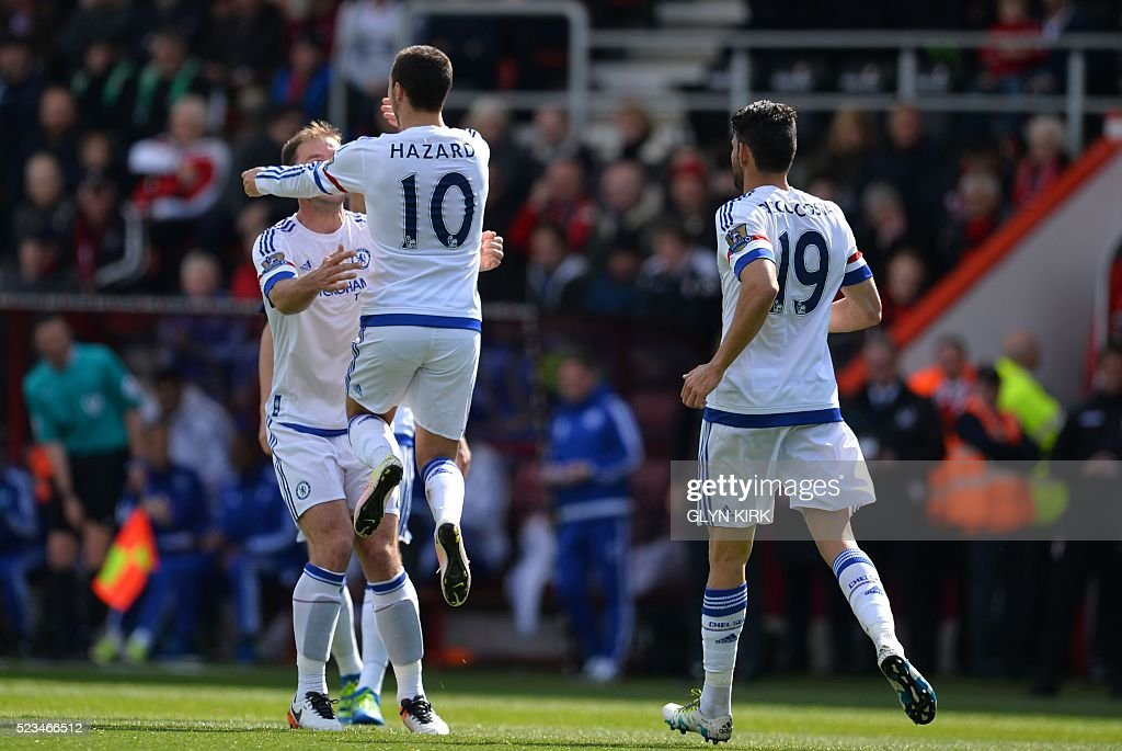 Chelsea's Belgian midfielder Eden Hazard (2nd L) celebrates with Chelsea's Serbian defender Branislav Ivanovic (L) after scoring their second goal during the English Premier League football match between Bournemouth and Chelsea at the Vitality Stadium in Bournemouth, southern England on April 23, 2016. / AFP / GLYN KIRK / RESTRICTED TO EDITORIAL USE. No use with unauthorized audio, video, data, fixture lists, club/league logos or 'live' services. Online in-match use limited to 75 images, no video emulation. No use in betting, games or single club/league/player publications. /