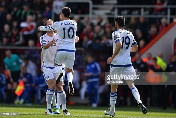 Chelsea's Belgian midfielder Eden Hazard celebrates with Chelsea's Serbian defender Branislav Ivanovic after scoring their second goal during the...