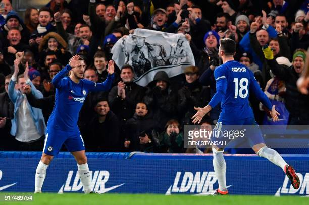 Chelsea's Belgian midfielder Eden Hazard celebrates with Chelsea's French attacker Olivier Giroud after scoring the opening goal during the English...