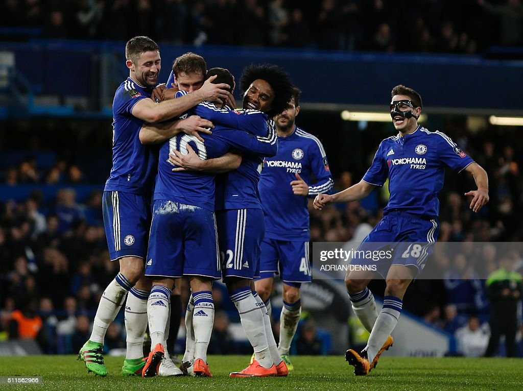 Chelsea's Belgian midfielder Eden Hazard (3rd L) celebrates with teammates after scoring their fourth goal during the English FA Cup fifth round football match between Chelsea and Manchester City at Stamford Bridge in London on February 21, 2016. / AFP / ADRIAN DENNIS / RESTRICTED TO EDITORIAL USE. No use with unauthorized audio, video, data, fixture lists, club/league logos or 'live' services. Online in-match use limited to 75 images, no video emulation. No use in betting, games or single club/league/player publications. /