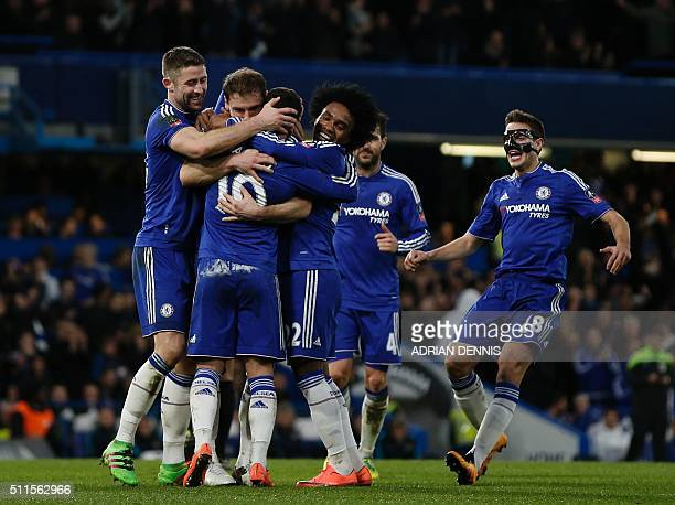 Chelsea's Belgian midfielder Eden Hazard celebrates with teammates after scoring their fourth goal during the English FA Cup fifth round football...