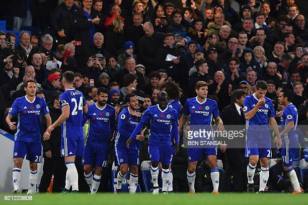Chelsea's Belgian midfielder Eden Hazard celebrates with teammates after scoring the opening goal of the English Premier League football match...