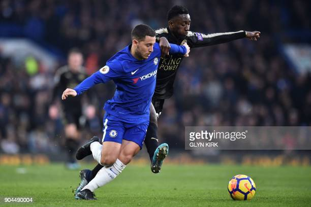 Chelsea's Belgian midfielder Eden Hazard competes with Leicester City's Nigerian midfielder Wilfred Ndidi during the English Premier League football...