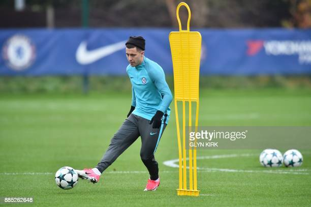 Chelsea's Belgian midfielder Eden Hazard controls the ball during a training session at Chelsea's Cobham training facility in Stoke D'Abernon...