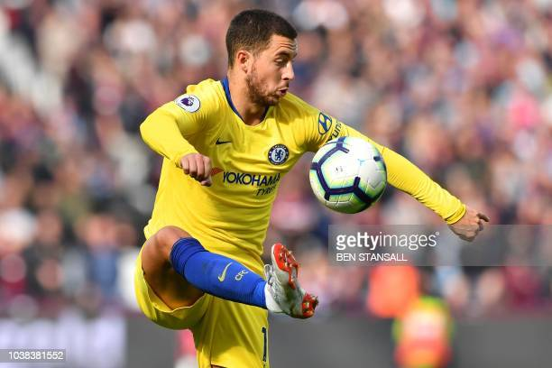 Chelsea's Belgian midfielder Eden Hazard controls the ball during the English Premier League football match between West Ham United and Chelsea at...