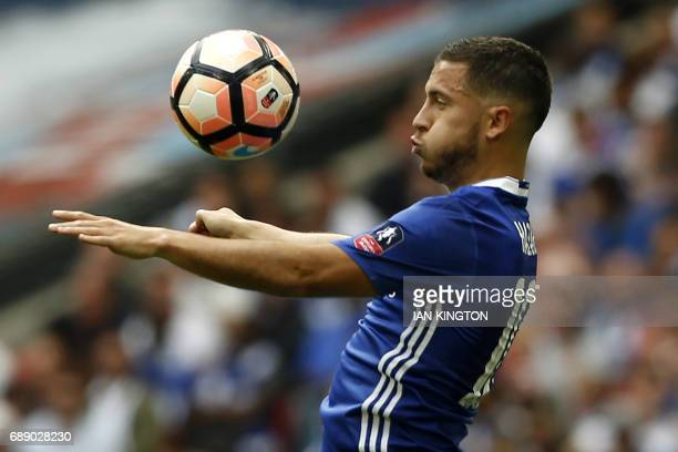 Chelsea's Belgian midfielder Eden Hazard controls the ball during the English FA Cup final football match between Arsenal and Chelsea at Wembley...